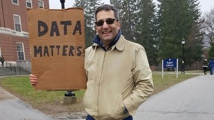 Alan Cobo-Lewis holding a cardboard sign that reads, Data Matters.