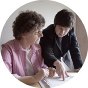 Two women reviewing business documents.