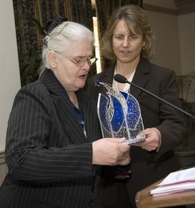 Maryanne Preble presents Susan Abel the Social Change award.