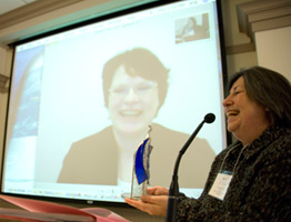 Kristine Mulhorn participates in ceremony via video conferencing.