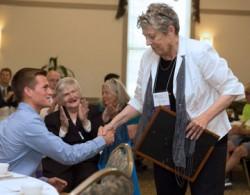 Award artist Dakota Douglas is greeted by Helen M. Bailey, Public Policy Change Award honoree.