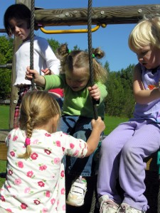 Children on an outside playset.