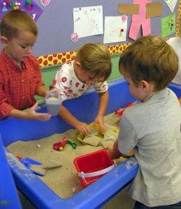 Children at a sandtable.