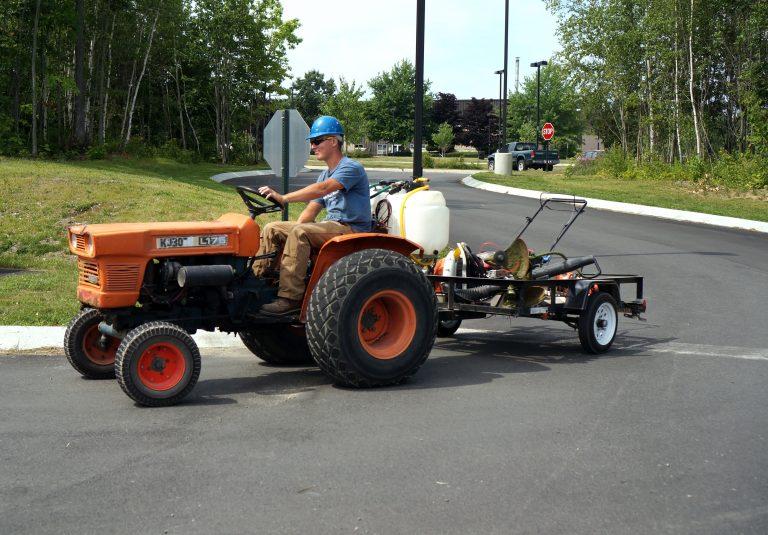 Grounds crew employee delivering equipment to EMCC worksite.