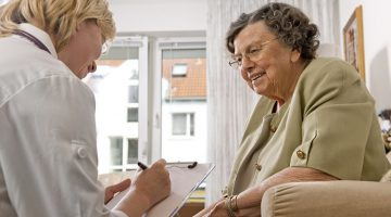 Senior Cargiver with Elderly Woman