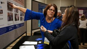 Susan Russell presenting poster at AUCD conference 2016.