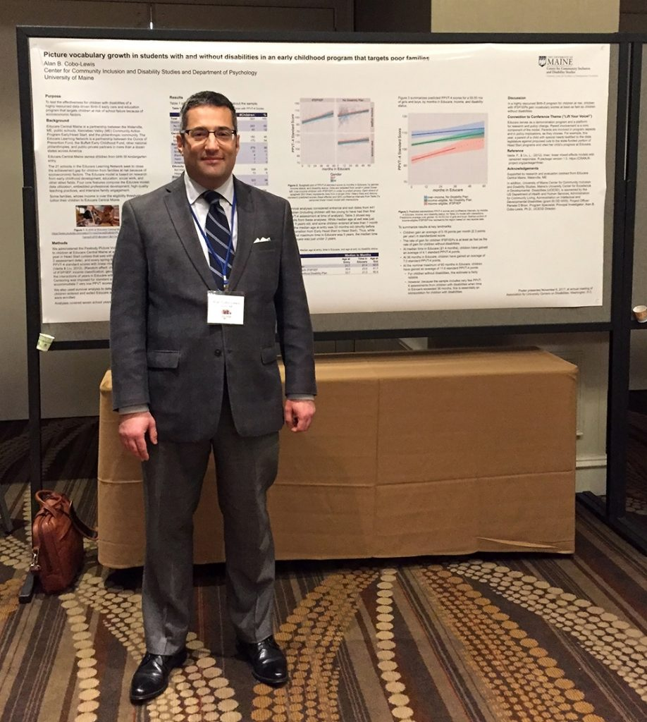 Alan Cobo-Lewis in front of his poster at the AUCD 2017 conference.