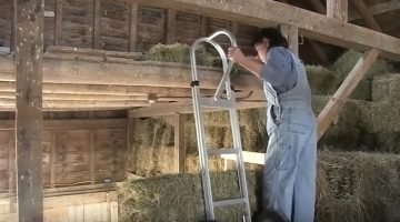Liz DePoy in the hayloft inher barn.