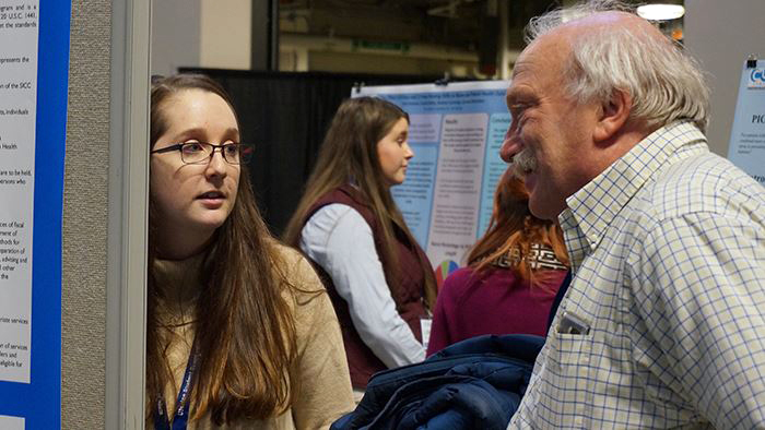 Holly Hegarty with Alan Kurtz at the 2018 University of Maine Student Symposium: Research and Creative Activity.