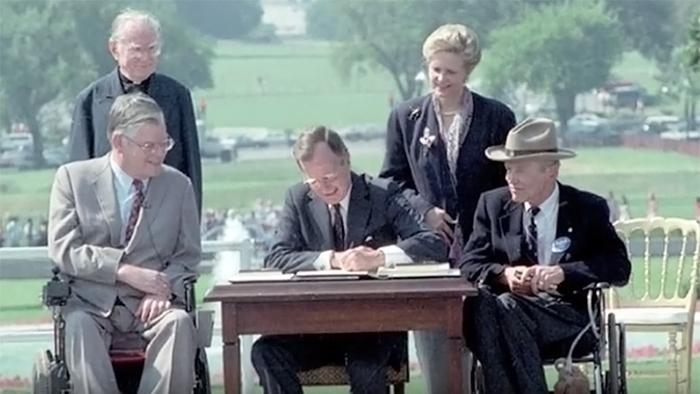 President George H.W. Bush signing the Americans with Disabilities Act (ADA), July 26, 1990.