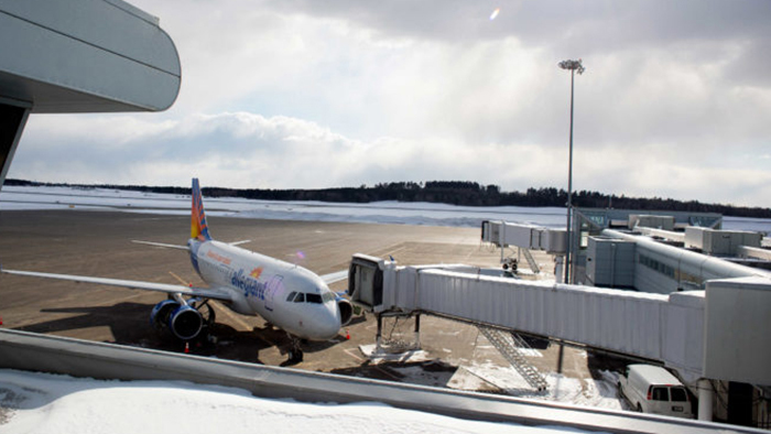 Allegiant Airlines plane parked at a gate at Bangor International Airport.