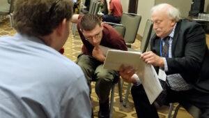 Alan Kurtz talking with self-advocates at AUCD conference.