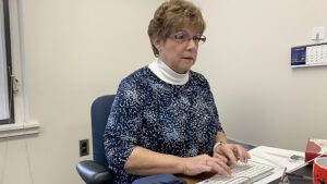 Bonnie Robinson working at her computer.