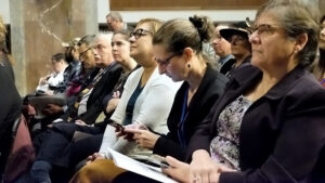 Audience listenting to closing plenary session at AUCD 2019 conference.