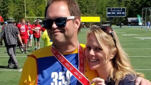 Eric and Tonya with their arms around each other at a 2019 Special Olympics event in Maine.