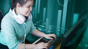 A blind woman with headphones who is typing on a braille keyboard. An artistic bar graph is overlayed in the teal background.